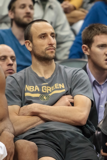 Apr 8, 2014; Minneapolis, MN, USA; San Antonio Spurs guard Manu Ginobili (20) sits on the bench at Target Center. Mandatory Credit: Brad Rempel-USA TODAY Sports