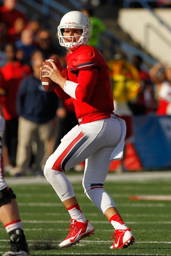 Nov 23, 2013; Fresno, CA, USA; Fresno State Bulldogs quarterback Derek Carr (4) looks to throw a pass against the New Mexico Lobos in the second quarter at Bulldog Stadium. The Bulldogs defeated the Lobos 69-28. Mandatory Credit: Cary Edmondson-USA TODAY Sports
