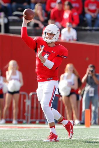 Nov 23, 2013; Fresno, CA, USA; Fresno State Bulldogs quarterback Derek Carr (4) throws a pass against the New Mexico Lobos in the first quarter at Bulldog Stadium. The Bulldogs defeated the Lobos 69-28. Mandatory Credit: Cary Edmondson-USA TODAY Sports