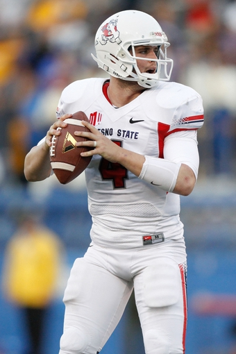 Nov 29, 2013; San Jose, CA, USA; Fresno State Bulldogs quarterback Derek Carr (4) prepares to throw a pass against the San Jose State Spartans in the fourth quarter at Spartan Stadium. The Spartans defeated the Bulldogs 62-52. Mandatory Credit: Cary Edmondson-USA TODAY Sports