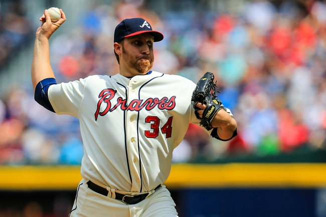Apr 13, 2014; Atlanta, GA, USA; Atlanta Braves starting pitcher Aaron Harang (34) pitches in the second inning against the Washington Nationals at Turner Field. Mandatory Credit: Daniel Shirey-USA TODAY Sports