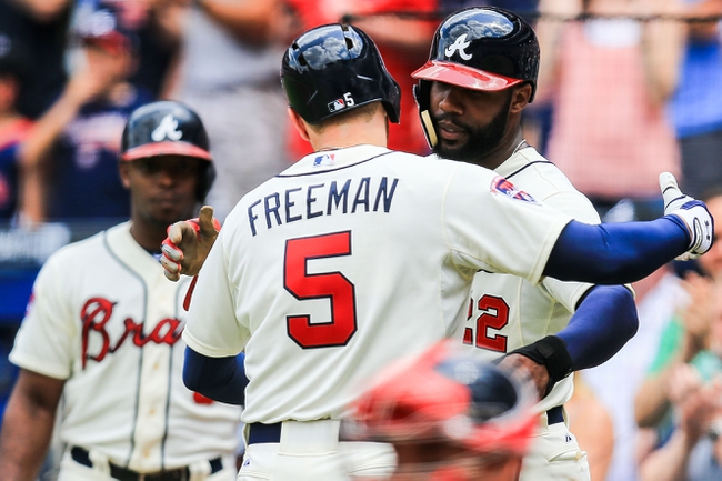 Apr 13, 2014; Atlanta, GA, USA; Atlanta Braves first baseman Freddie Freeman (5) celebrates with right fielder Jason Heyward (22) after a two run home run in the second inning at Turner Field. Mandatory Credit: Daniel Shirey-USA TODAY Sports