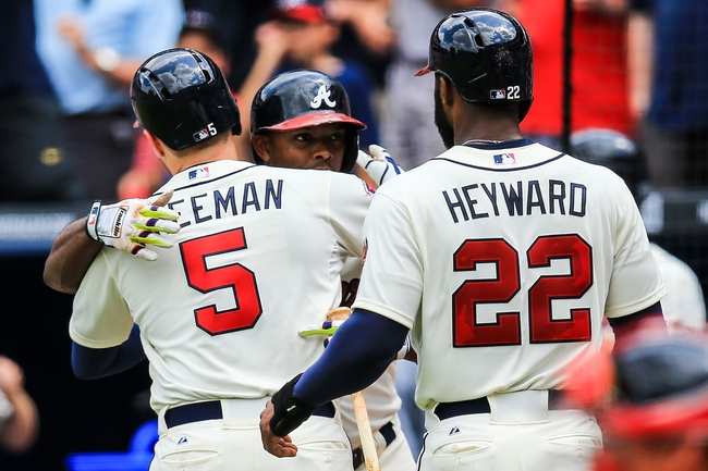 Apr 13, 2014; Atlanta, GA, USA; Atlanta Braves first baseman Freddie Freeman (5) celebrates with left fielder Justin Upton (8) after a two run home run in the second inning at Turner Field. Mandatory Credit: Daniel Shirey-USA TODAY Sports