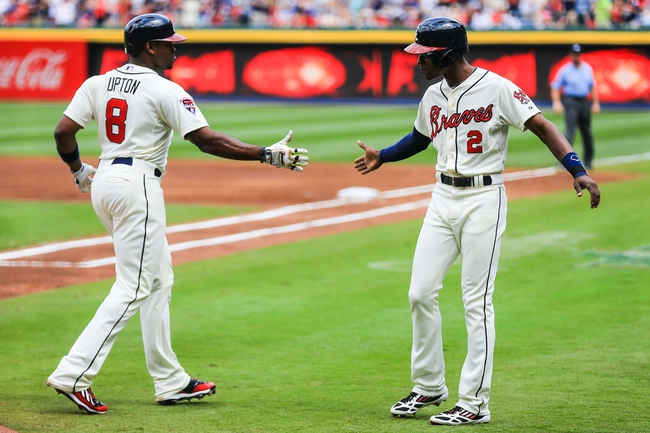 Apr 13, 2014; Atlanta, GA, USA; Atlanta Braves left fielder Justin Upton (8) celebrates with center fielder B.J. Upton (2) after a two run home run in the first inning against the Washington Nationals at Turner Field. Mandatory Credit: Daniel Shirey-USA TODAY Sports