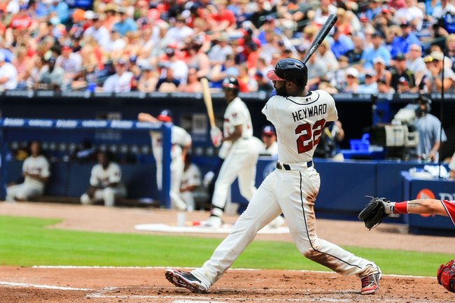 Apr 13, 2014; Atlanta, GA, USA; Atlanta Braves right fielder Jason Heyward (22) hits an RBI double in the second inning against the Washington Nationals at Turner Field. Mandatory Credit: Daniel Shirey-USA TODAY Sports