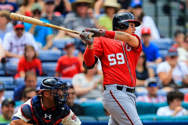 Apr 13, 2014; Atlanta, GA, USA; Washington Nationals catcher Jose Lobaton (59) drives in a run in the fifth inning against the Atlanta Braves at Turner Field. Mandatory Credit: Daniel Shirey-USA TODAY Sports