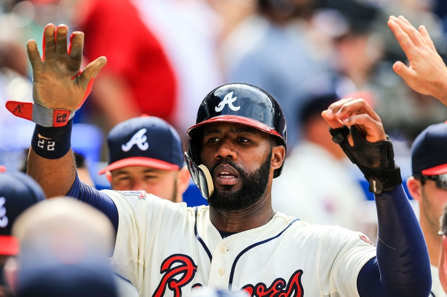Apr 13, 2014; Atlanta, GA, USA; Atlanta Braves right fielder Jason Heyward (22) celebrates with teammates after scoring in the eighth inning against the Washington Nationals at Turner Field. Mandatory Credit: Daniel Shirey-USA TODAY Sports