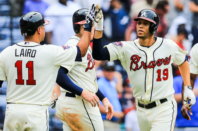 Apr 13, 2014; Atlanta, GA, USA; Atlanta Braves shortstop Andrelton Simmons (19) celebrates with teammates after a three run home run in the eighth inning against the Washington Nationals at Turner Field. Mandatory Credit: Daniel Shirey-USA TODAY Sports