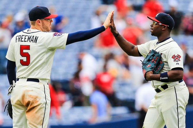 Apr 13, 2014; Atlanta, GA, USA; Atlanta Braves first baseman Freddie Freeman (5) celebrates with left fielder Justin Upton (8) after defeating the Washington Nationals 10-2 at Turner Field. Mandatory Credit: Daniel Shirey-USA TODAY Sports