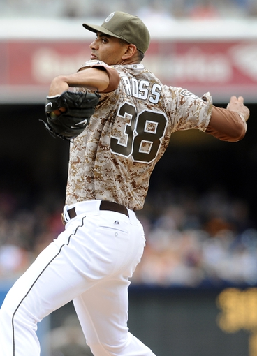 Apr 13, 2014; San Diego, CA, USA; San Diego Padres starting pitcher Tyson Ross (38) throws during the first inning against the Detroit Tigers at Petco Park. Mandatory Credit: Christopher Hanewinckel-USA TODAY Sports