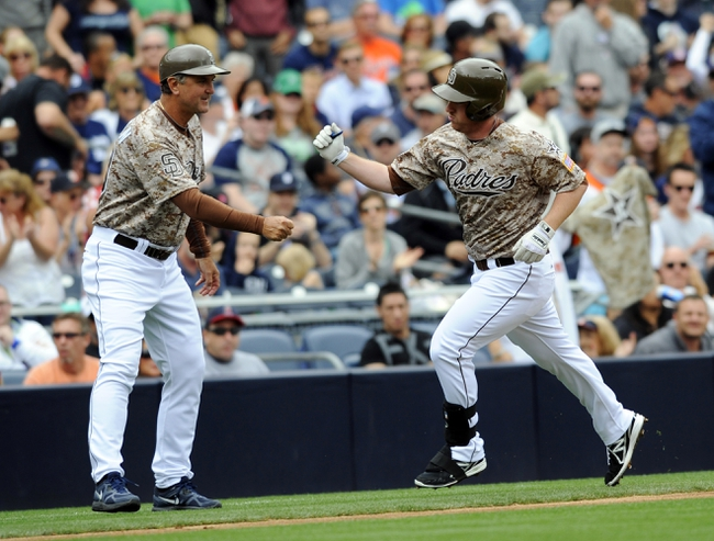Apr 13, 2014; San Diego, CA, USA; San Diego Padres second baseman Jedd Gyorko (9) is congratulated by third base coach Glenn Hoffman (left) after a home run during the second inning against the Detroit Tigers at Petco Park. Mandatory Credit: Christopher Hanewinckel-USA TODAY Sports