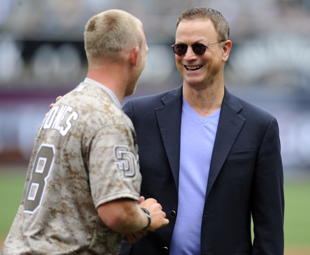Apr 13, 2014; San Diego, CA, USA; Actor and humanitarian Gary Sinise (right) talks with USMC veteran Rob Jones after Jones threw out the honorary first pitch on military opening day before the San Diego Padres game against the Detroit Tigers at Petco Park. Mandatory Credit: Christopher Hanewinckel-USA TODAY Sports