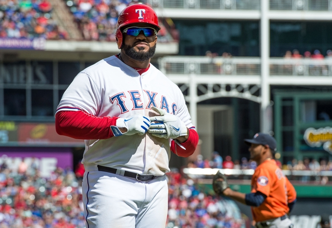Apr 13, 2014; Arlington, TX, USA; Texas Rangers first baseman Prince Fielder (84) reacts to lining out with runners in scoring position during the sixth inning against the Houston Astros at Globe Life Park in Arlington. Mandatory Credit: Jerome Miron-USA TODAY Sports