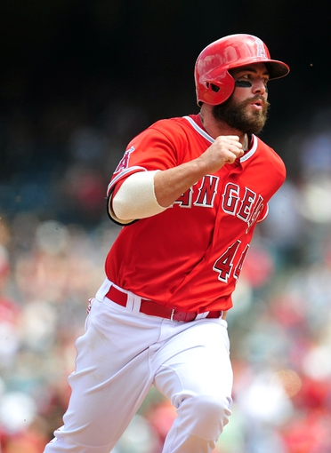 April 13, 2014; Anaheim, CA, USA; Los Angeles Angels first baseman Ian Stewart (44) advances to third in the fourth inning against the New York Mets at Angel Stadium of Anaheim. Mandatory Credit: Gary A. Vasquez-USA TODAY Sports