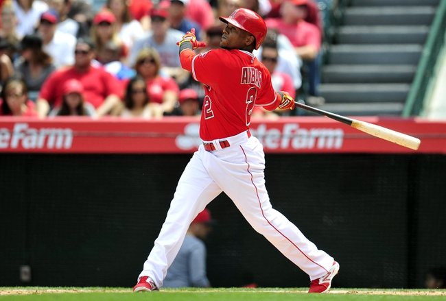 April 13, 2014; Anaheim, CA, USA; Los Angeles Angels shortstop Erick Aybar (2) hits a two run RBI triple in the fourth inning against the New York Mets at Angel Stadium of Anaheim. Mandatory Credit: Gary A. Vasquez-USA TODAY Sports