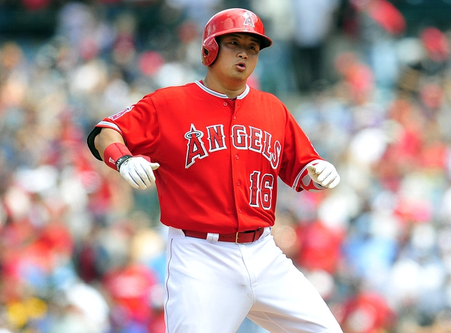 April 13, 2014; Anaheim, CA, USA; Los Angeles Angels catcher Hank Conger (16) reacts after hitting a double in the fourth inning against the New York Mets at Angel Stadium of Anaheim. Mandatory Credit: Gary A. Vasquez-USA TODAY Sports