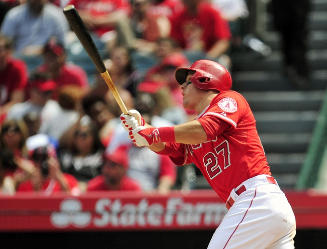 April 13, 2014; Anaheim, CA, USA; Los Angeles Angels center fielder Mike Trout (27) hits a single in the sixth inning against the New York Mets at Angel Stadium of Anaheim. Mandatory Credit: Gary A. Vasquez-USA TODAY Sports