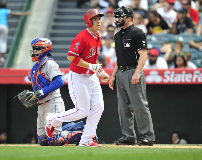 April 13, 2014; Anaheim, CA, USA; Los Angeles Angels left fielder J.B. Shuck (3) scores a run of a walk in the sixth inning against the New York Mets at Angel Stadium of Anaheim. Mandatory Credit: Gary A. Vasquez-USA TODAY Sports