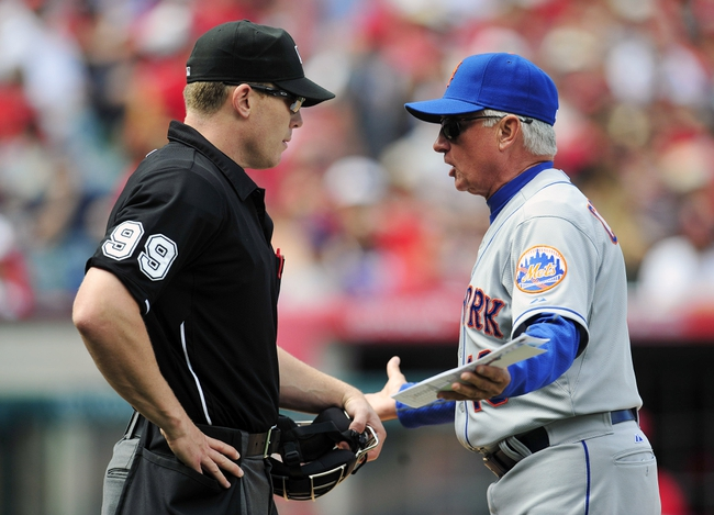 April 13, 2014; Anaheim, CA, USA; New York Mets manager Terry Collins (10) argues a call with home plate umpire Toby Basner (left) during the seventh inning at Angel Stadium of Anaheim. Mandatory Credit: Gary A. Vasquez-USA TODAY Sports