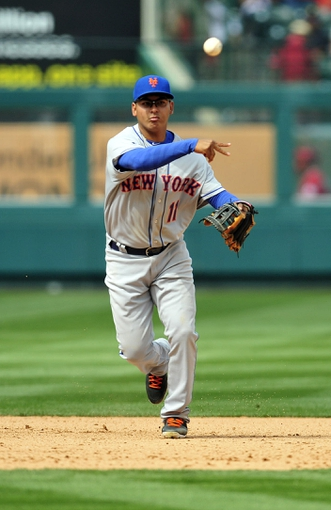April 13, 2014; Anaheim, CA, USA; New York Mets shortstop Ruben Tejada (11) throws to first to complete an out in the seventh inning against the Los Angeles Angels at Angel Stadium of Anaheim. Mandatory Credit: Gary A. Vasquez-USA TODAY Sports