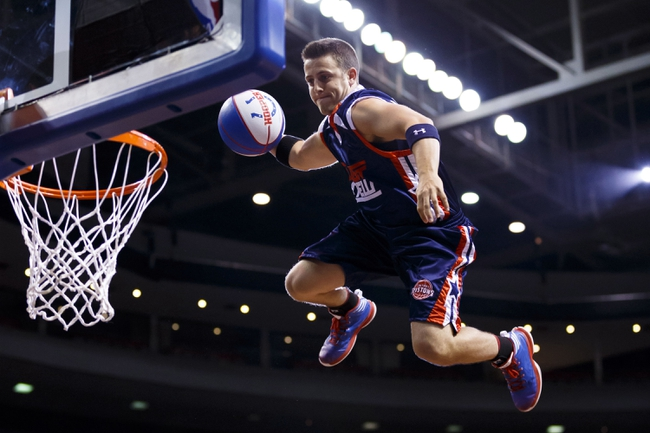 Apr 13, 2014; Auburn Hills, MI, USA; Member of the Detroit Pistons Flight Crew performs during a time out against the Toronto Raptors at The Palace of Auburn Hills. Mandatory Credit: Rick Osentoski-USA TODAY Sports
