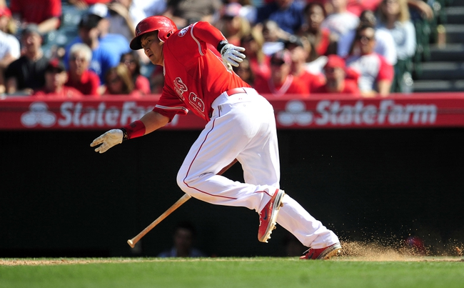 April 13, 2014; Anaheim, CA, USA; Los Angeles Angels catcher Hank Conger (16) runs after an at bat in the eighth inning against the New York Mets at Angel Stadium of Anaheim. Mandatory Credit: Gary A. Vasquez-USA TODAY Sports