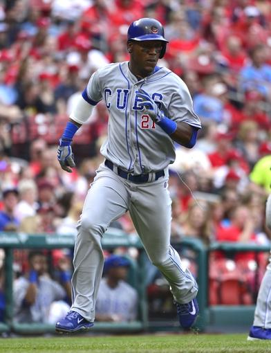 Apr 13, 2014; St. Louis, MO, USA; Chicago Cubs left fielder Junior Lake (21) scores a run against the St. Louis Cardinals at Busch Stadium. The Cardinals won 6-4. Mandatory Credit: Scott Rovak-USA TODAY Sports