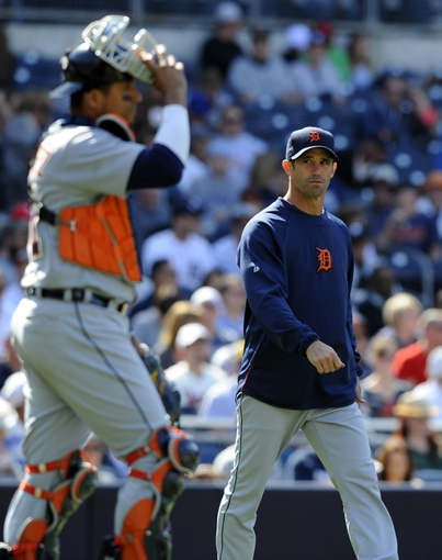 Apr 13, 2014; San Diego, CA, USA; Detroit Tigers manager Brad Ausmus (7) walks to the mound to make a pitching change during the seventh inning against the San Diego Padres at Petco Park. Mandatory Credit: Christopher Hanewinckel-USA TODAY Sports