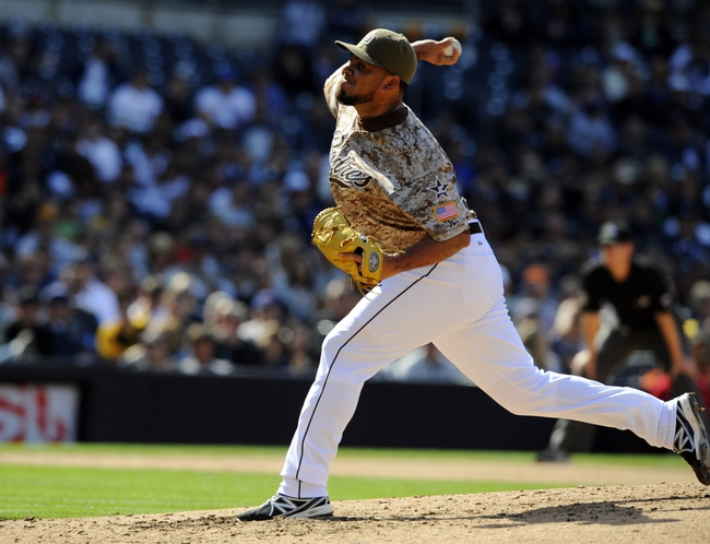 Apr 13, 2014; San Diego, CA, USA; San Diego Padres relief pitcher Joaquin Benoit (56) throws during the eighth inning against the Detroit Tigers at Petco Park. Mandatory Credit: Christopher Hanewinckel-USA TODAY Sports