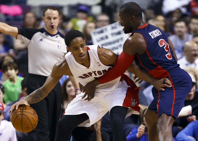 Apr 13, 2014; Auburn Hills, MI, USA; Toronto Raptors guard DeMar DeRozan (10) is defended by Detroit Pistons guard Rodney Stuckey (3) in the second half at The Palace of Auburn Hills. Mandatory Credit: Rick Osentoski-USA TODAY Sports