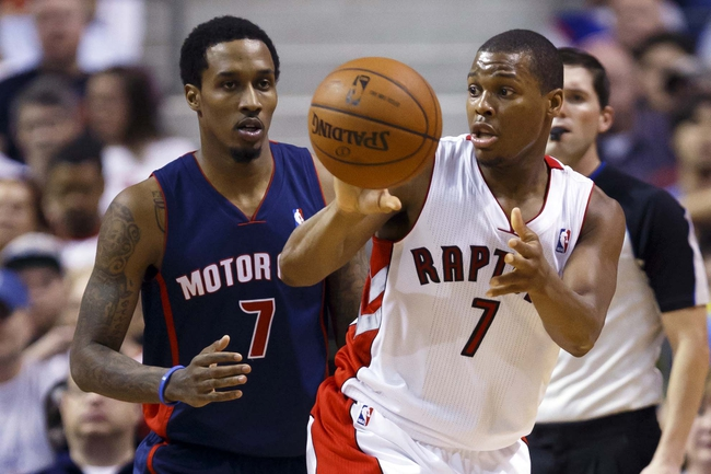 Apr 13, 2014; Auburn Hills, MI, USA; Toronto Raptors guard Kyle Lowry (7) passes the ball away from Detroit Pistons guard Brandon Jennings (7) in the second half at The Palace of Auburn Hills. Mandatory Credit: Rick Osentoski-USA TODAY Sports