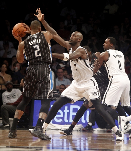 Apr 13, 2014; Brooklyn, NY, USA; Brooklyn Nets forward Kevin Garnett (2) defends against Orlando Magic forward Kyle O   Quinn (2) in the second quarter at Barclays Center. Mandatory Credit: Nicole Sweet-USA TODAY Sports