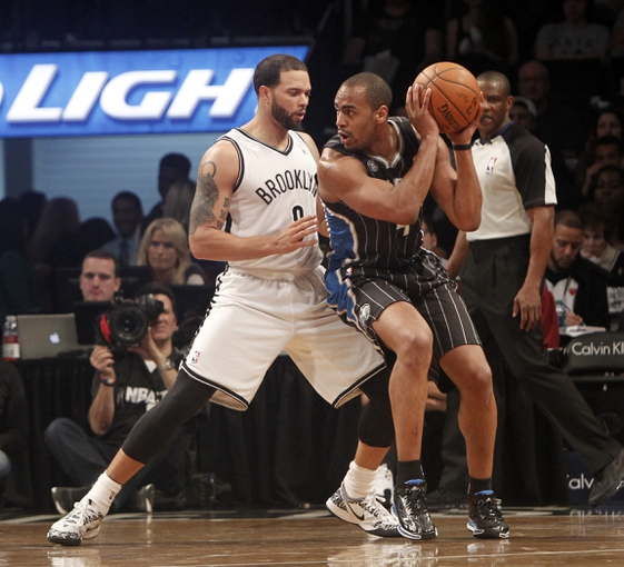Apr 13, 2014; Brooklyn, NY, USA; Brooklyn Nets guard Deron Williams (8) defends against Orlando Magic guard Arron Afflalo (4) in the second quarter at Barclays Center. Mandatory Credit: Nicole Sweet-USA TODAY Sports