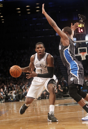 Apr 13, 2014; Brooklyn, NY, USA; Brooklyn Nets guard Joe Johnson (7) drives to the basket against Orlando Magic guard Doron Lamb (1) in the third quarter at Barclays Center. Nets win 97-88. Mandatory Credit: Nicole Sweet-USA TODAY Sports