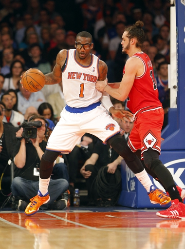 Apr 13, 2014; New York, NY, USA;  New York Knicks forward Amar'e Stoudemire (1) works against Chicago Bulls center Joakim Noah (13) during the first half at Madison Square Garden. Mandatory Credit: Jim O'Connor-USA TODAY Sports