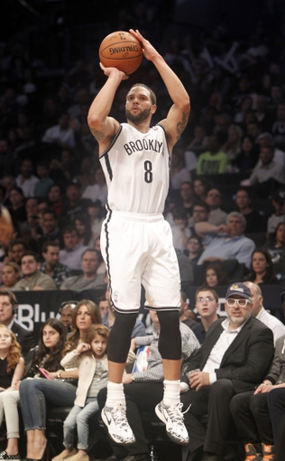 Apr 13, 2014; Brooklyn, NY, USA; Brooklyn Nets guard Deron Williams (8) puts up a shot against Orlando Magic in the fourth quarter at Barclays Center. Nets win 97-88. Mandatory Credit: Nicole Sweet-USA TODAY Sports