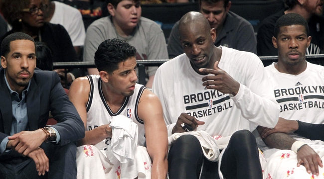 Apr 13, 2014; Brooklyn, NY, USA; Brooklyn Nets forward Kevin Garnett (2) talks to  guard Jorge Gutierrez (13) in the second quarter against Orlando Magic at Barclays Center. Nets win 97-88. Mandatory Credit: Nicole Sweet-USA TODAY Sports