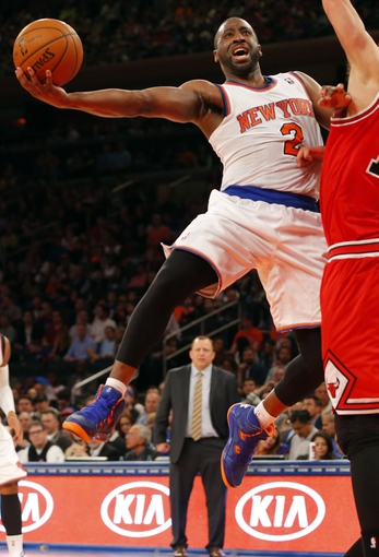 Apr 13, 2014; New York, NY, USA;  New York Knicks guard Raymond Felton (2) drives to the basket during the second half against the Chicago Bulls at Madison Square Garden. New York Knicks defeat the Chicago Bulls 100-89. Mandatory Credit: Jim O'Connor-USA TODAY Sports