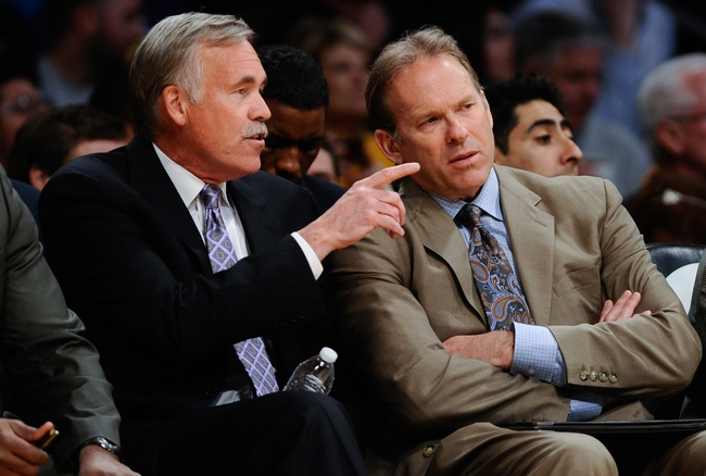 Apr 13, 2014; Los Angeles, CA, USA; Los Angeles Lakers head coach Mike D'Antoni talks to assistant coach Kurt Rambis during the second quarter against the Memphis Grizzlies at Staples Center. Mandatory Credit: Robert Hanashiro-USA TODAY Sports