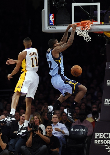 Apr 13, 2014; Los Angeles, CA, USA; Memphis Grizzlies forward Ed Davis (32) dunks against Los Angeles Lakers forward Wesley Johnson (11) during second quarter action at Staples Center. Mandatory Credit: Robert Hanashiro-USA TODAY Sports