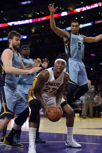 Apr 13, 2014; Los Angeles, CA, USA;  Los Angeles Lakers forward Jordan Hill (27) tries to score between Memphis Grizzlies center Marc Gasol (33), forward Zach Randolph (50) and guard Mike Conley (11) during the third quarter at Staples Center. Mandatory Credit: Robert Hanashiro-USA TODAY Sports