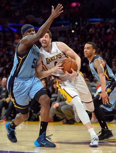 Apr 13, 2014; Los Angeles, CA, USA;  Los Angeles Lakers forward Ryan Kelly (4) tries to drive between Memphis Grizzlies forward Zach Randolph (50) and guard Courtney Lee (5) during the fourth quarter at Staples Center. Mandatory Credit: Robert Hanashiro-USA TODAY Sports