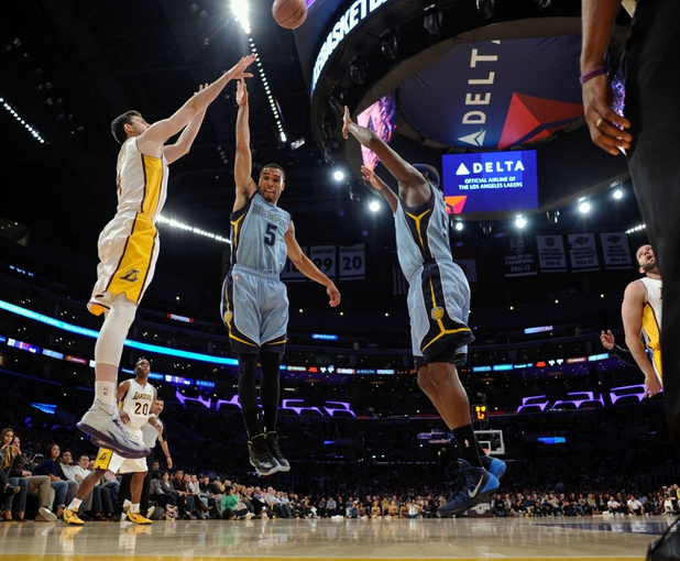 Apr 13, 2014; Los Angeles, CA, USA;  Los Angeles Lakers forward Ryan Kelly (4) shoots a 3-pointe shot over Memphis Grizzlies guard Courtney Lee (5) and forward Zach Randolph (50) during third quarter action at Staples Center. Mandatory Credit: Robert Hanashiro-USA TODAY Sports