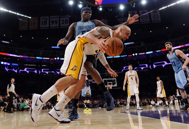 Apr 13, 2014; Los Angeles, CA, USA; Los Angeles Lakers center Robert Sacre (50) tries to drive the baseline on Memphis Grizzlies forward Zach Randolph (50) during third quarter action at Staples Center. Mandatory Credit: Robert Hanashiro-USA TODAY Sports