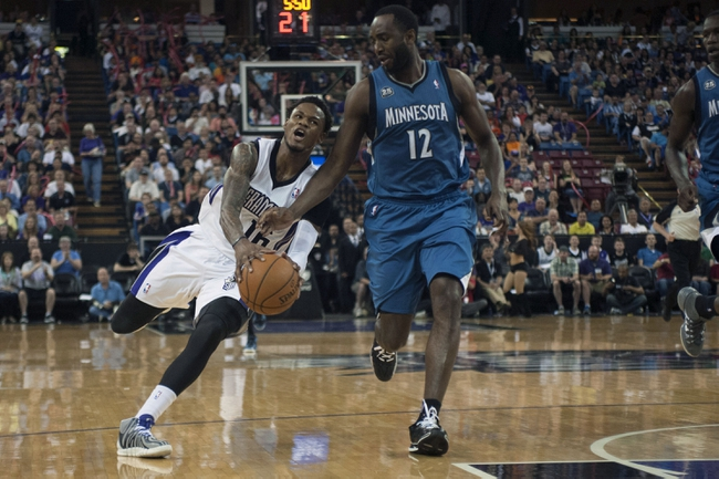 Apr 13, 2014; Sacramento, CA, USA; Minnesota Timberwolves forward Luc Richard Mbah a Moute (12) attempts to steal the ball from Sacramento Kings guard Ben McLemore (16) during the third quarter at Sleep Train Arena. The Sacramento Kings defeated the Minnesota Timberwolves 106-103. Mandatory Credit: Ed Szczepanski-USA TODAY Sports