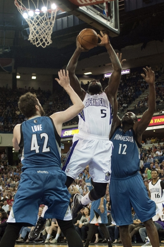 Apr 13, 2014; Sacramento, CA, USA; Sacramento Kings forward Quincy Acy (5) rebounds the ball over Minnesota Timberwolves forward Kevin Love (42) and forward Luc Richard Mbah a Moute (12) during the third quarter at Sleep Train Arena. The Sacramento Kings defeated the Minnesota Timberwolves 106-103. Mandatory Credit: Ed Szczepanski-USA TODAY Sports