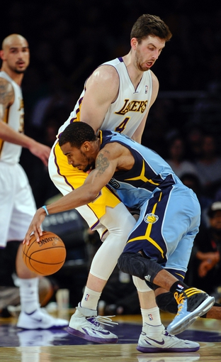 Apr 13, 2014; Los Angeles, CA, USA;  Memphis Grizzlies guard Mike Conley (11) runs into Los Angeles Lakers forward Ryan Kelly (4) during the 4th quarter at Staples Center. Mandatory Credit: Robert Hanashiro-USA TODAY Sports