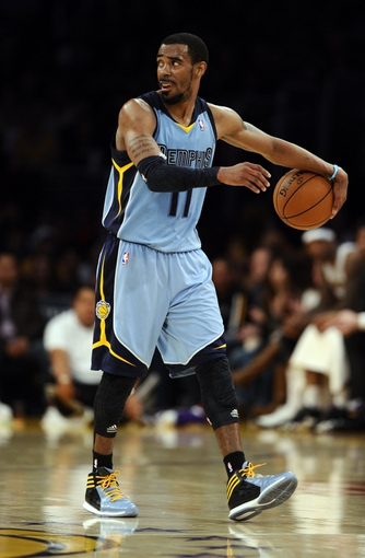 Apr 13, 2014; Los Angeles, CA, USA; Memphis Grizzlies guard Mike Conley (11) during the Grizzlies 102-90 win over the Los Angeles Lakers at Staples Center. Mandatory Credit: Robert Hanashiro-USA TODAY Sports
