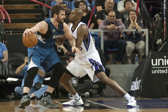 Apr 13, 2014; Sacramento, CA, USA; Minnesota Timberwolves forward Kevin Love (42) fights for position with Sacramento Kings forward Travis Outlaw (25) during the first quarter at Sleep Train Arena. The Sacramento Kings defeated the Minnesota Timberwolves 106-103. Mandatory Credit: Ed Szczepanski-USA TODAY Sports