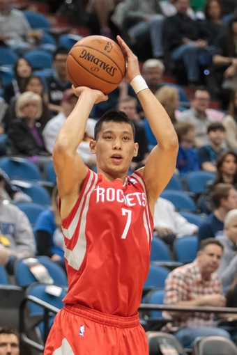 Apr 11, 2014; Minneapolis, MN, USA; Houston Rockets guard Jeremy Lin (7) shoots against the Minnesota Timberwolves at Target Center. The Minnesota Timberwolves win 112-110. Mandatory Credit: Brad Rempel-USA TODAY Sports